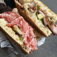 Prosciutto literally falling out of the fresh baked sandwiches at All'Antico Vinaio.