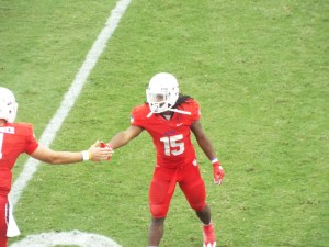 RB Devontae Jackson Shakes hands with quarterback Will Gardner after his touchdown pass.
