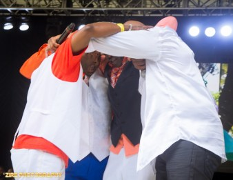 Hip-Hop Legends Whodini and UTFO form a group huddle after Live Performance at the Rock Steady Crew 38th Annual Celebration held on Sunday, July 26, 2015 at Central Park in New York City