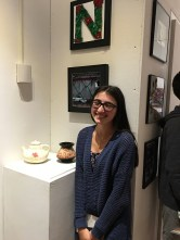 Nora Golbari with her work
