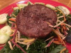 Niman Ranch burger over greens