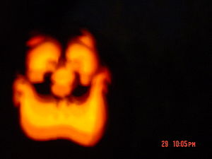 Blurry pumpkin lamp at night