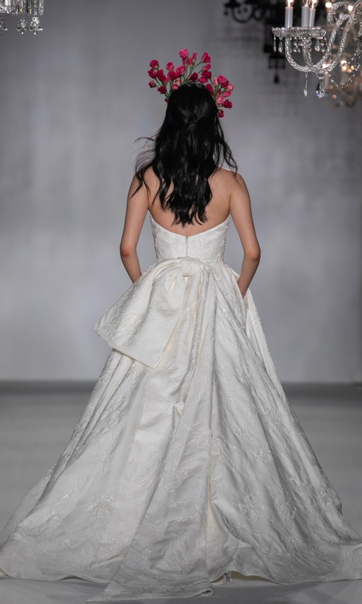 Strapless beaded ballgown with large back bow