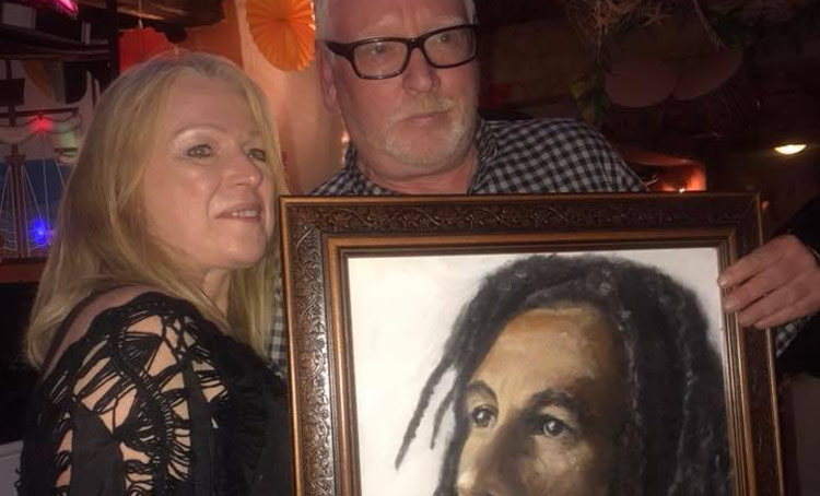 MazArtistry dontated a canvas of Bob Marley