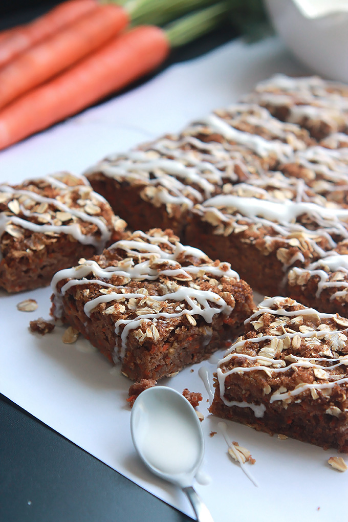 Carrot for breakfast, why not when they're in these moist delicious Vegan Carrot Cake Bars topped with brown sugar, oats and a sweet citrus glaze.