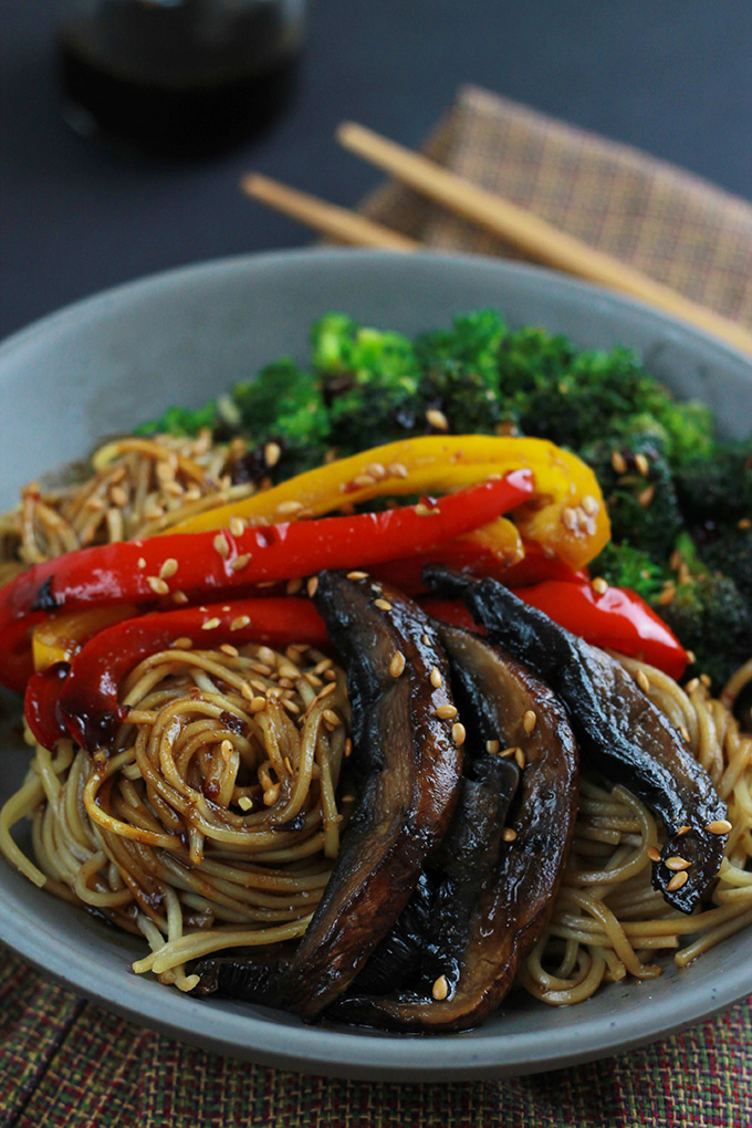 Close-up of Ramen, red and yellow peppers, mushrooms and broccoli in a bowl