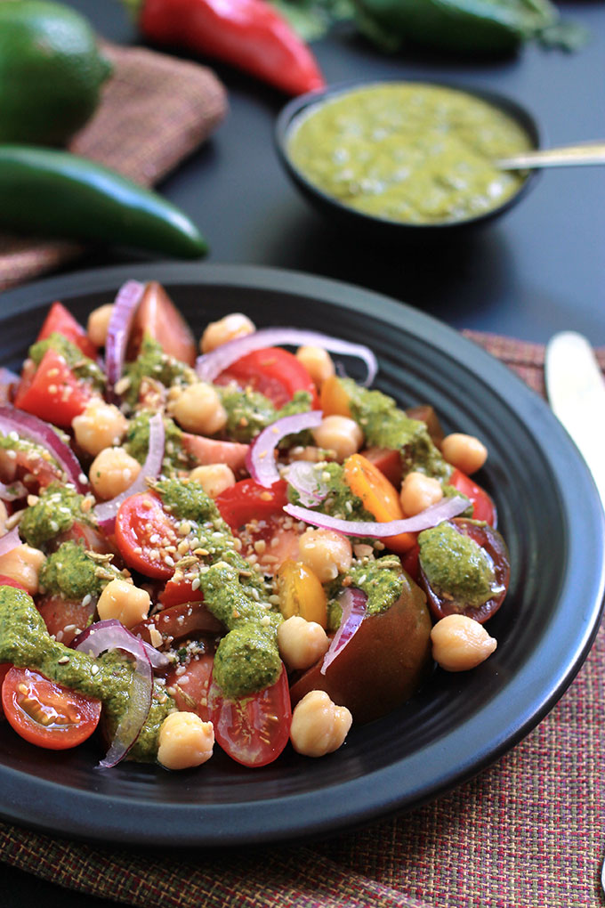 Cilantro Chutney with Heirloom Tomato Salad will amaze your tastebuds. This Cilantro Chutney is a bold and spicy Indian condiment perfect for sandwiches, snacks and so much more. Have fun exploring the possibilities.