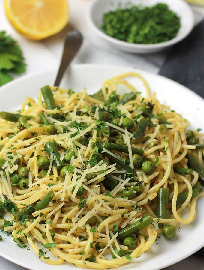 Fresh mix of herbs over crisp veggies and tender pasta finished off with a squeeze of lemon juice, this Herbed Green Bean and Pea Pasta sings spring.