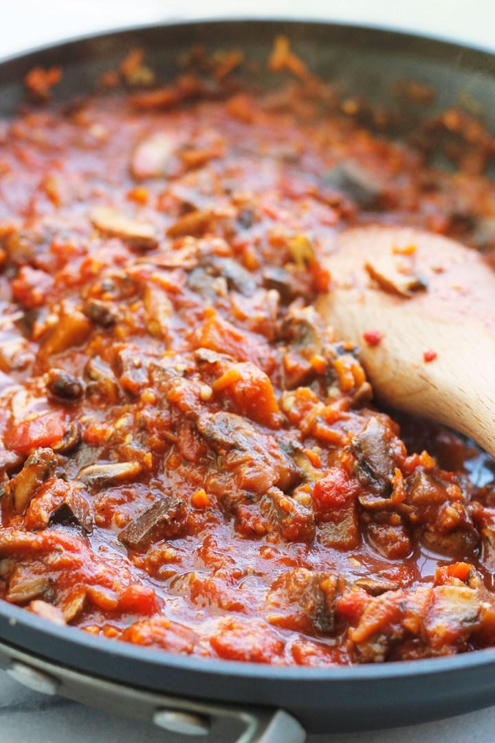 Simmering Vegan Eggplant Mushroom Sauce in saute pan.