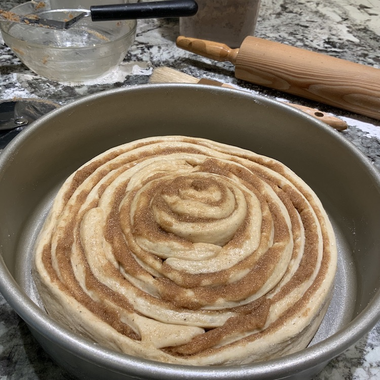 Colossal cinnamon roll dough in pan