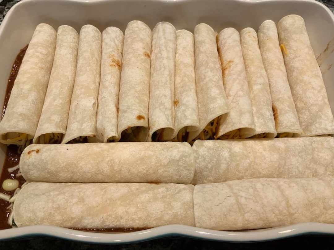 Cheese and Veggie Enchiladas rolled into their pan