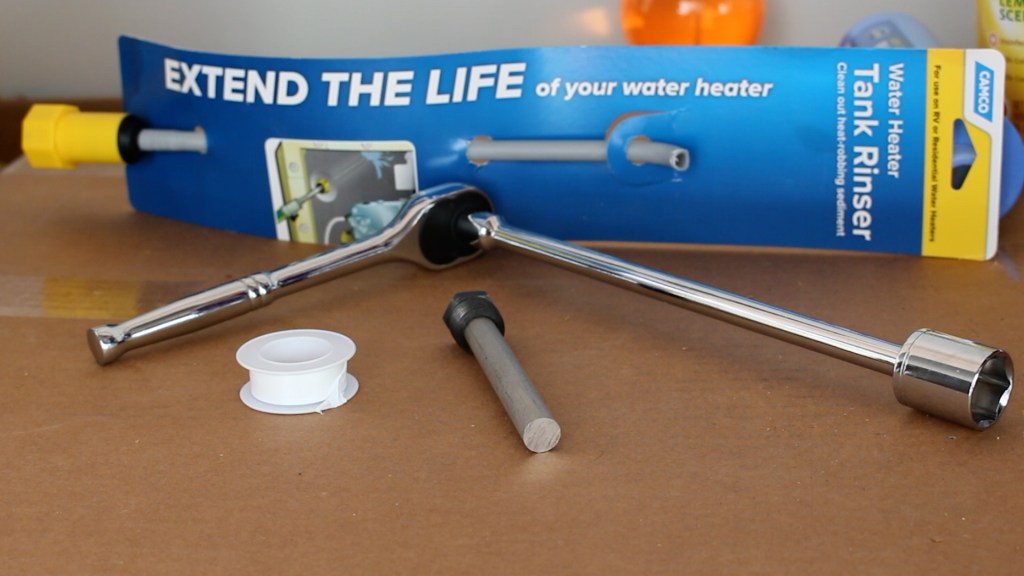 Tank Rinser, 21 mm socket wrench, plumbers tape and anode for Atwood water heater all used to flush our RV water heater