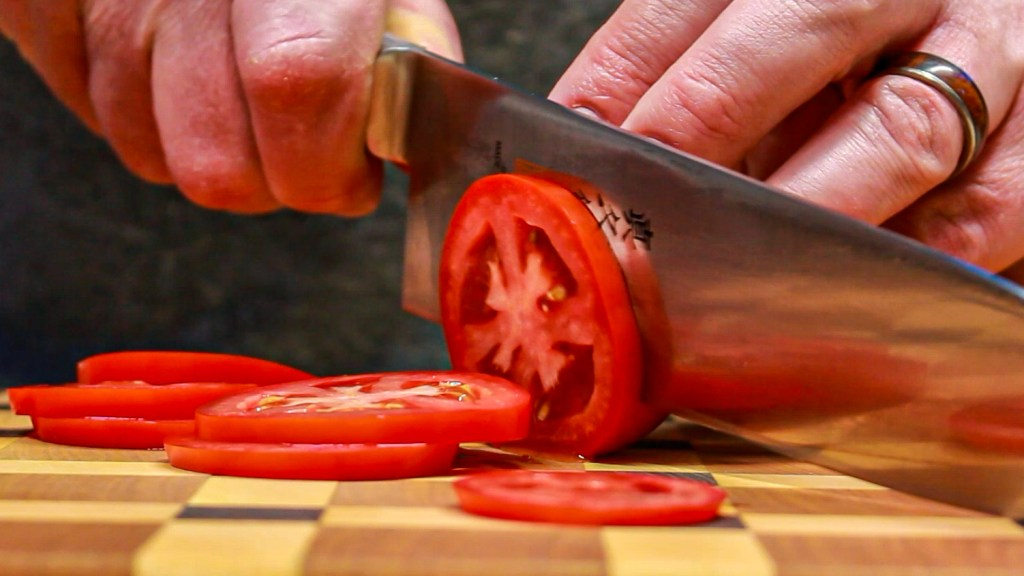 Sliced Roma tomatoes for Gyros