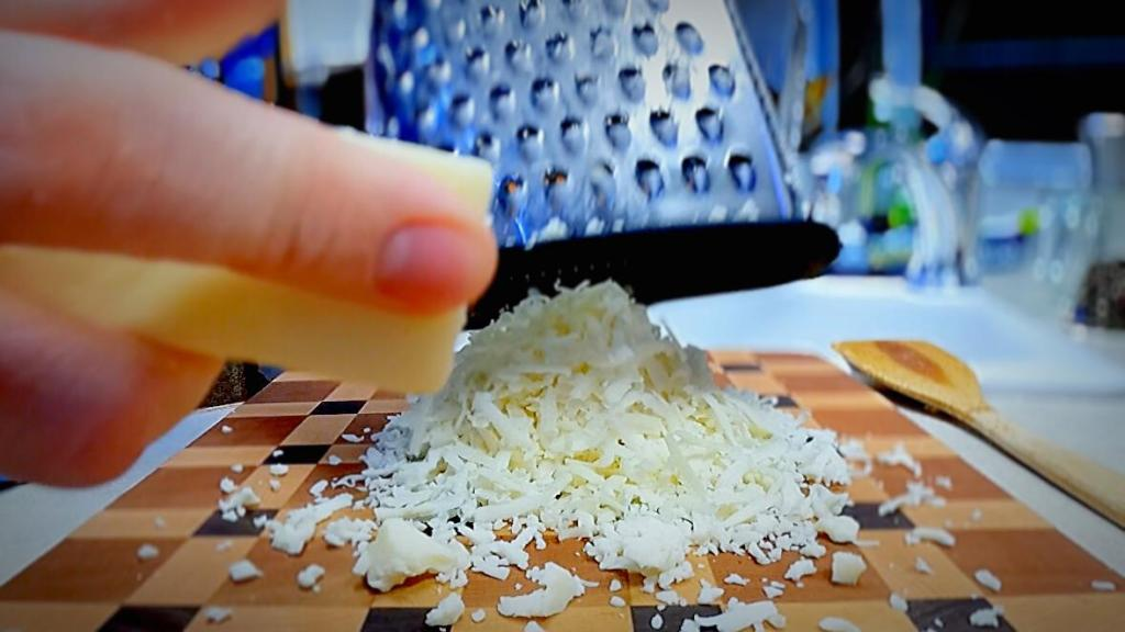 grate mozzarella cheese for the philly cheesesteak