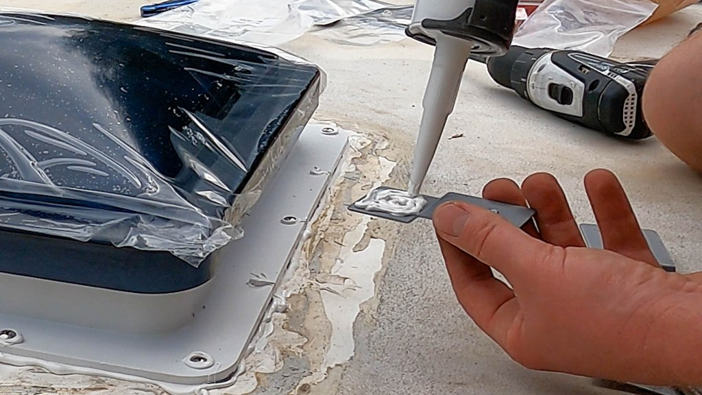 apply plenty of sealant to the rain hood mounting bracket that is to contact with the RV roof vent fan mounting surface