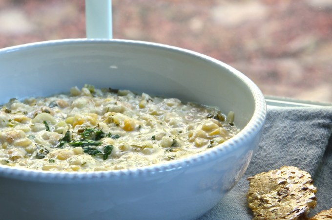Hearty Persian yogurt soup, also known as Ashe Mast, filled with potatoes, chickpeas, and lentils.