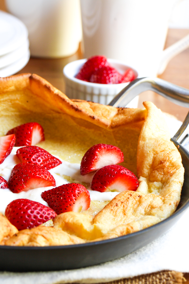 German pancake with strawberries and sweetened ricotta cheese.