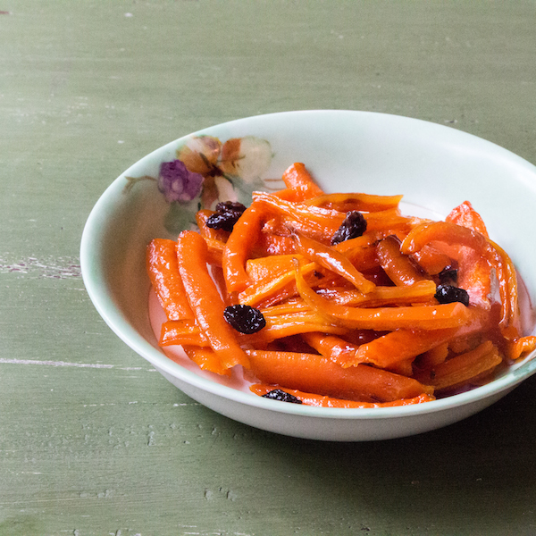 candied carrots with maple syrup toss with currants.