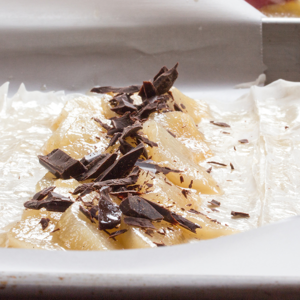 Wine-poached spiced pears layered in a phyllo crust with chocolate and rum-soaked dried cherries.
