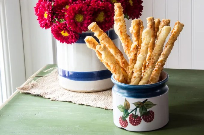 Easy cheddar cheese twists made with frozen puff pastry!