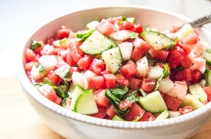 Refreshing watermelon salsa with peaches, cucumbers, cilantro, and lime for easy entertaining.