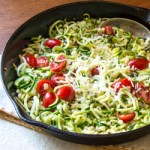 Spiralized zucchini, with garlic, tomatoes, and asiago cheese. Zoodles!