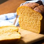 Tender loaf of bread that includes a mashed sweet potato, and sweetened with a little honey.