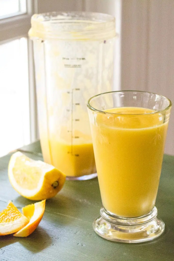 Orange mango smoothie with oranges, mango, ginger, and lime.