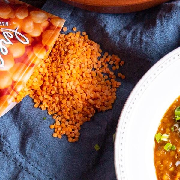 The best ever lentil soup made with red lentils, tomatoes, ginger, garlic, and coconut milk. #VeganRecipe #VeganSoup #LentilSoup #HealthyRecipes #CleanEating #InstantPotSoup #InstantPotRecipe #InstantPotVegan