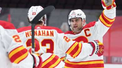 OTTAWA, ON - MARCH 24: Mark Giordano #5 of the Calgary Flames celebrates his second period goal against the Ottawa Senators with teammate Sean Monahan #23 at Canadian Tire Centre on March 24, 2021 in Ottawa, Ontario, Canada. (Photo by Andre Ringuette/NHLI via Getty Images)