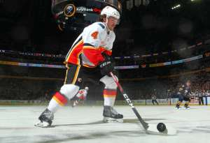 BUFFALO, NY - NOVEMBER 27: Rasmus Andersson #4 of the Calgary Flames skates with the puck during an NHL game against the Buffalo Sabres on November 27, 2019 at KeyBank Center in Buffalo, New York. (Photo by Sara Schmidle/NHLI via Getty Images)