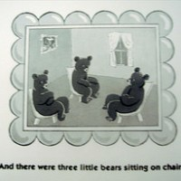 Three Little Bears Sitting on Chairs