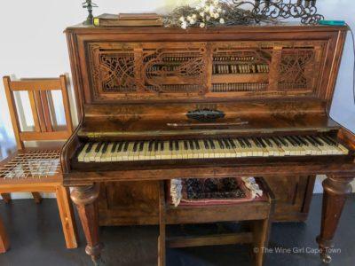vintage piano in tasting room