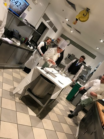 CIA Greystone culinary students busy at work in the Gatehouse Restaurant kitchen