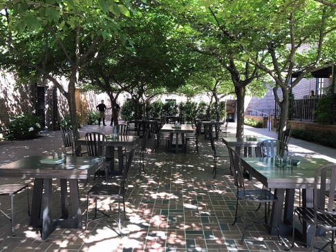 The outdoor terrace on a Sunday getting ready for brunch -The Charter Oak Restaurant