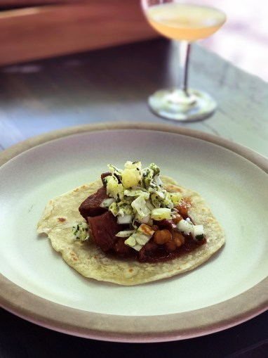 Pork Posole - A traditional Mexican celebratory dish - Tostada style