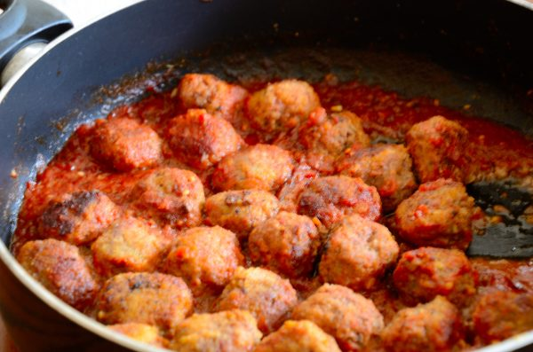 Sherry Meatballs in a frying pan with tomato sauce