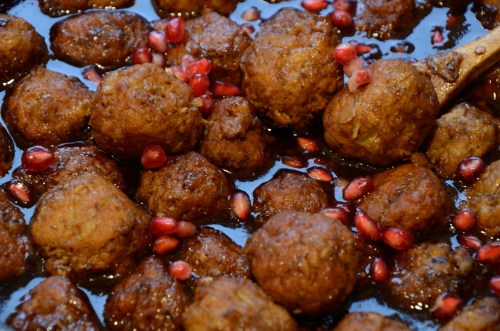 pomegranate-meatballs-in-skillet-with-sauce
