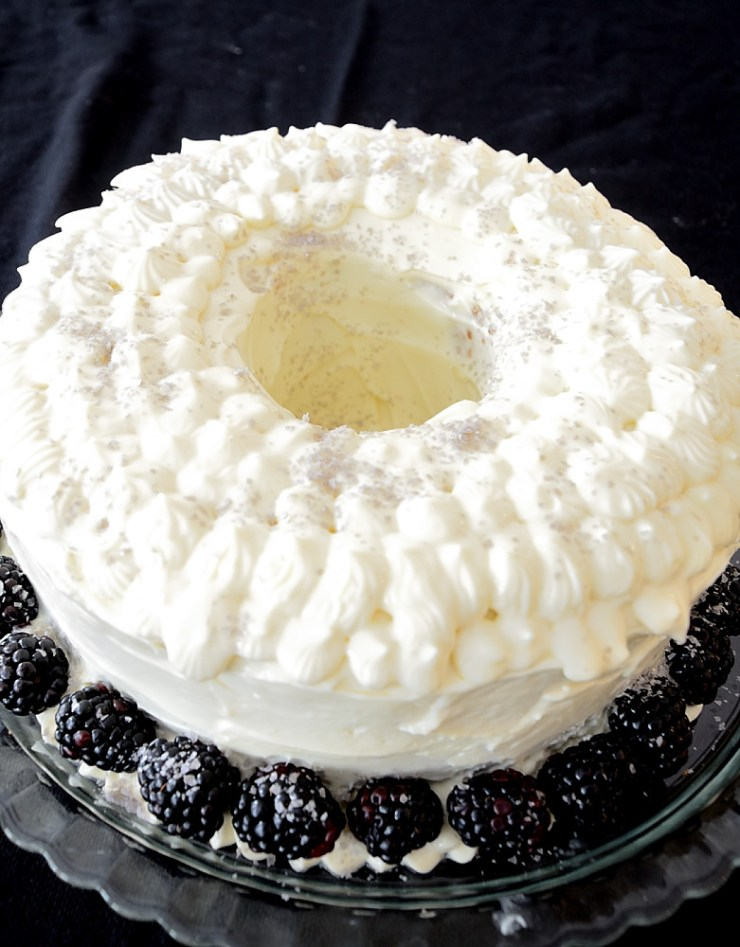 This Raspberry Liqueur Cake with Cream Cheese Icing is dense and moist and delicious! It is perfect for entertaining.