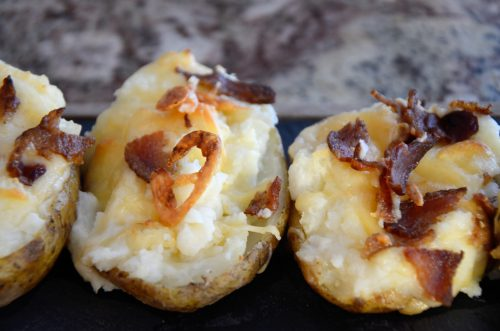 Baked Potatoes topped with Cheddar and Bacon Bits
