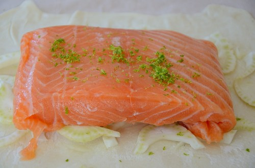 Salmon flilet centered on bed of fennel and puff pastry.