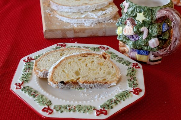 Classic Christmas Stollen sliced on a tea plate