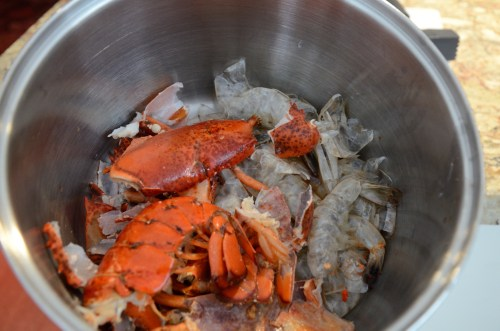 Lobster carcass in stock pot with shrimp shells