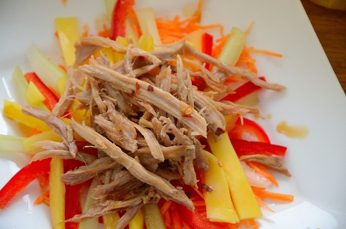 Shredded duck meat on bed of julienned mango, carrot and celery