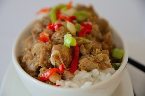 Cubed pork with caramelized sauce, red peppers and green onions.