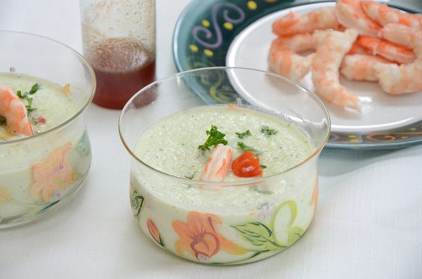 Cold cucumber soup with shrimp and paprika syrup garnish
