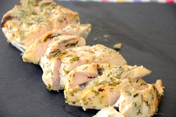 Grilled Chicken with Dijon Tarragon coating sliced on serving tray