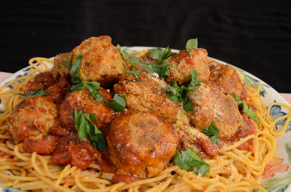 Platter of spaghetti with sauce and meatballs
