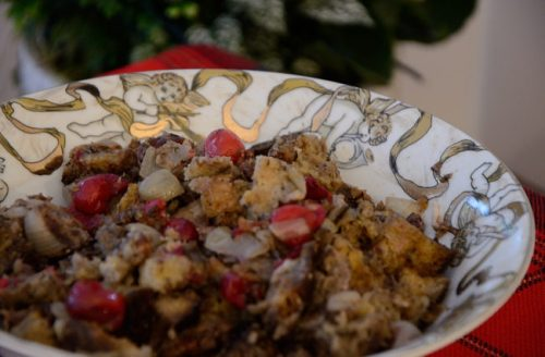 A bowl of bread stuffing with cranberries and pecans