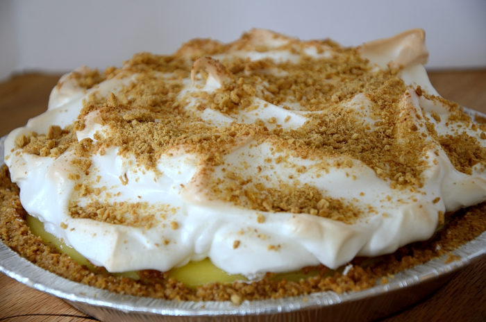 Whole pie with meringue topping and graham crumbs on top.